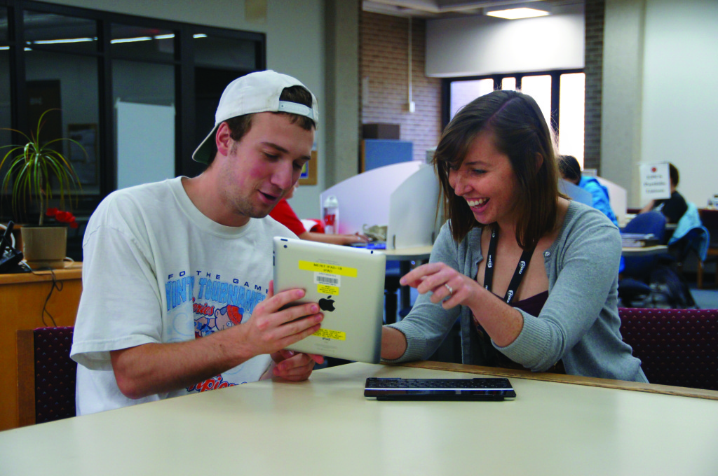 Mary Vogt, MLIS student at University of Wisconsin–Madison (UW), with undergraduate Beau Blakeley. Vogt works as a graduate student assistant at the Media, Education Resources, and Information Technology Library in the School of Education.
