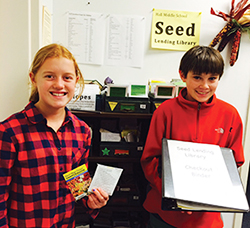 Annika and Jack, 7th graders at Hall Middle School in Larkspur, California, show off the school's seed lending library.