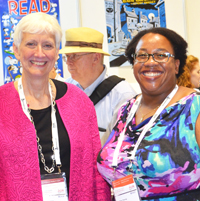 ALA President Barbara K. Stripling (left) and ALA President-Elect Courtney L. Young at the IFLA Exhibits. Photo by Carlon Walker