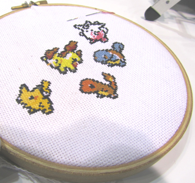 Pokémon creatures march across a cross-stitch sampler created at Detroit Public Library's HYPE Maker Space.