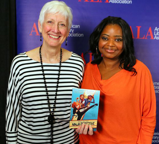 Actor Octavia Spencer (right) with ALA President Barbara K. Stripling. Spencer is holding a copy of her new children's book.