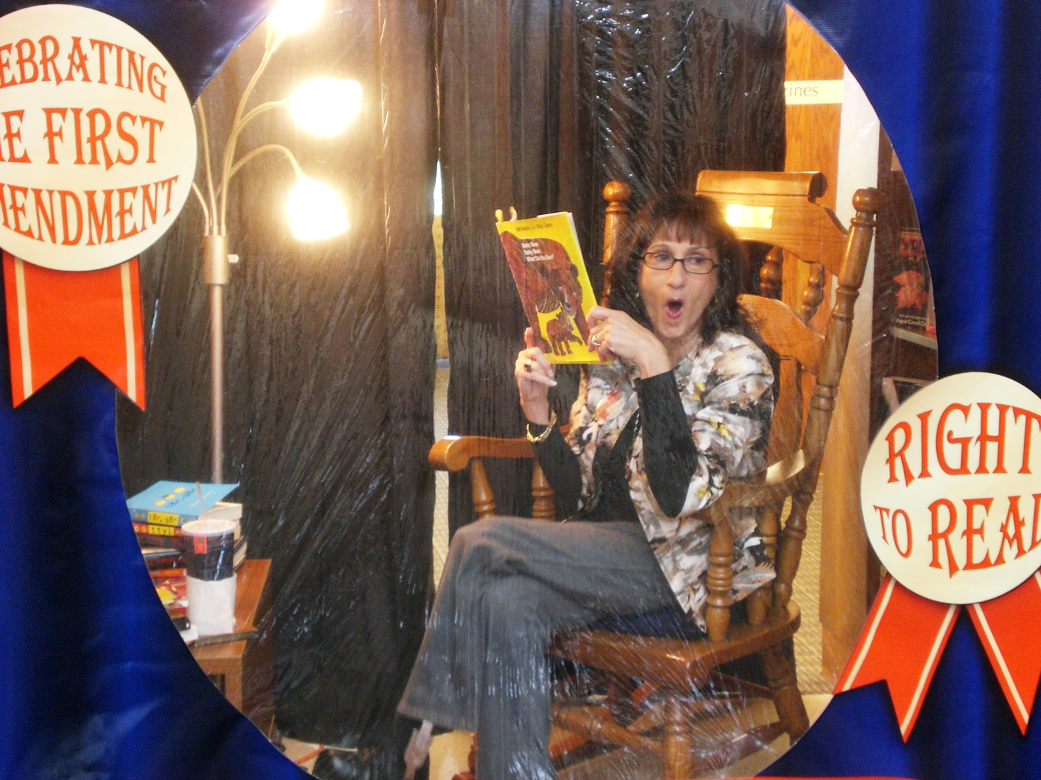 "Debbie Hatz, Coralville (Iowa) Public Library board member, poses in the ""Live Humans Reading"" display that drew 103 volunteer readers for a total of 64 hours."