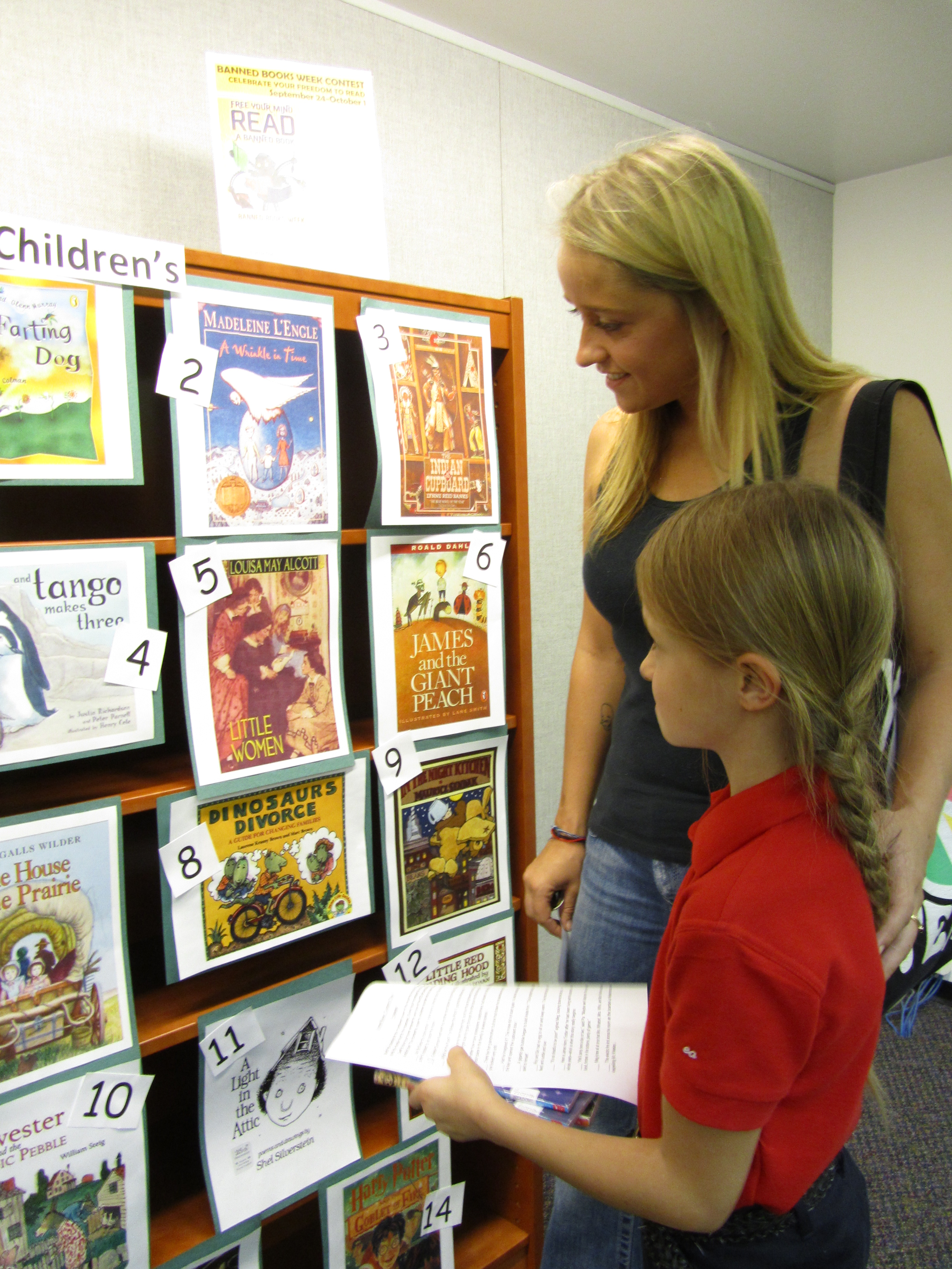 Patrons match passages from banned books with their respective covers at Bemis Public Library in Littleton, Colorado. More than 30 book covers were on display.