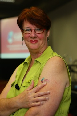 Cheryl Gorman, vice president of national programs at the Harwood Institute, points to her tattoo (Photo: Cognotes)