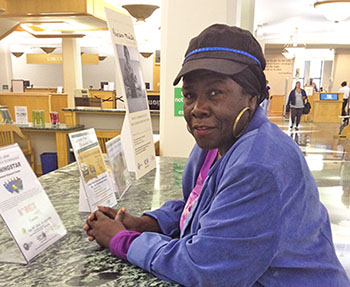 """The library feeds my soul and my mind,"" says Dorothy Sterling, pictured here at the Harold Washington Library Center in Chicago. As a homeless patron, Sterling says she relies on the library to check in on the day's events."