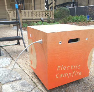 The Electric Campfire, parked outside the O Henry House, is plugged in and ready to charge.