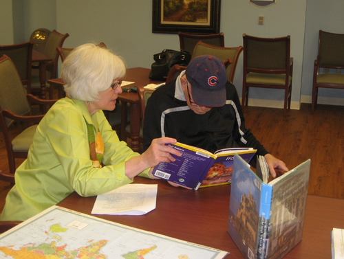"""Karen Maki, deputy director of GBPL, with a """"traveler"""" who is participating in the Tales and Travels program."""
