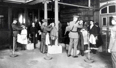 Public Health Service physicians are shown screening immigrants on Ellis Island in this undated photo
