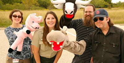 Members of the cast from the Denton Public Library's Library Larry television show are shown with Danielle Bradley, second from left, an employee at Ray Roberts Lake State Park. The cast, which includes, from left, WyLaina Polk (Emmy Lou Dickenson), Kerol Harrod (Library Larry) and Chuck Voellinger (Mr. Chompers), filmed an episode of the show at the state park in north Denton County.
