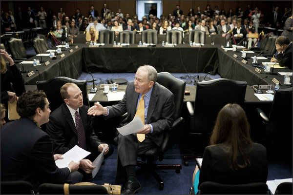US Sen. Lamar Alexander (R-Tenn.) center, chairman of the Senate education committee, talks with staff members as the committee prepares to mark up a proposed reauthorization of the Elementary and Secondary Education Act