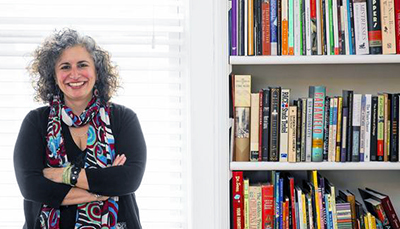 Office for Library Advocacy Director Marci Merola and her home bookshelf