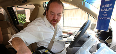 After making a house call, Demetrios Leontaris, owner of NYC iPod Doctor, repaired an iPhone in his van. Photo by Nicole Bengiveno/The New York Times