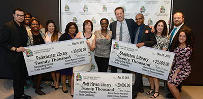 Parkchester, Stapleton, and Mott Haven Libraries accept the award