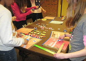 Members of Bridgewater Library's tween advisory group work at a crafting table.