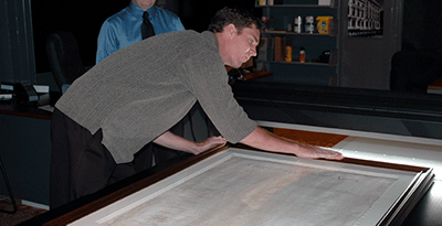 The Athenaeum's Jim Carroll scanning New Jersey's copy of the Bill of Rights in 2006
