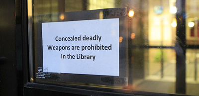 Concealed weapon sign at Lexington (Ky.) Central Library, 2013