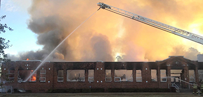Early on the morning of January 7, 2015, Old Dock Elementary School staff watched as fire fighters battled a blaze that would consume one of the main buildings of the school