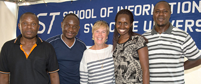 Rwandan students pose with former iSchool Dean Liz Liddy during their residency in Syracuse in 2013. From left to right: Ali Kaleeba, Jean Pierre Mugiraneza, Dean Liddy, Chantal Dusabe Kabanda, and Bernard Bahati