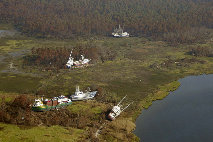 A cargo ship and fishing boats left grounded in Bayou La Batre, Alabama, after Hurricane Katrina came through in 2005. Photo: NOAA