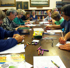 Members gather for the monthly coloring club at the library.