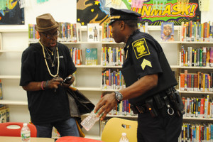 Hartford resident Olusanya Bey talks with Sgt. Steve Austin of the Hartford Police Department before the Hartford Public Library's community dialogue on public safety and community violence in June.