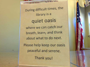 A sign in the Ferguson Municipal Public Library during last year's unrest.