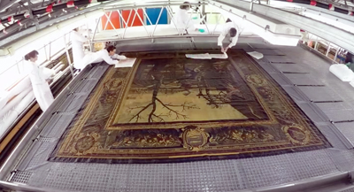 Washing the Mortlake tapestry (still from video)