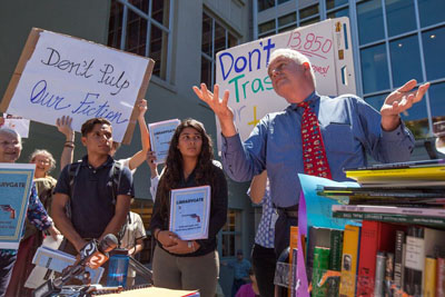 Berkeley councilmember Kriss Worthington, right, addresses Aug. 12, 2015 protest over at Berkeley Public Library over head librarian Jeff Scott's process or winnowing out old books. Scott has resigned over the controversy.