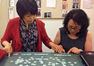 "At the Littleton Immigrant Resources Center, students work with tiles to practice spelling for the writing portion of the citizenship exam. <span class=""credit"">Photo: Bemis Library</span>"
