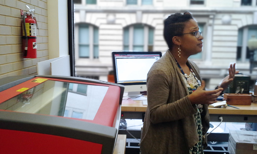 Maryann James-Daley, interim manager of The Labs at DC Public Library, talks about the safety precautions for using the laser cutter.