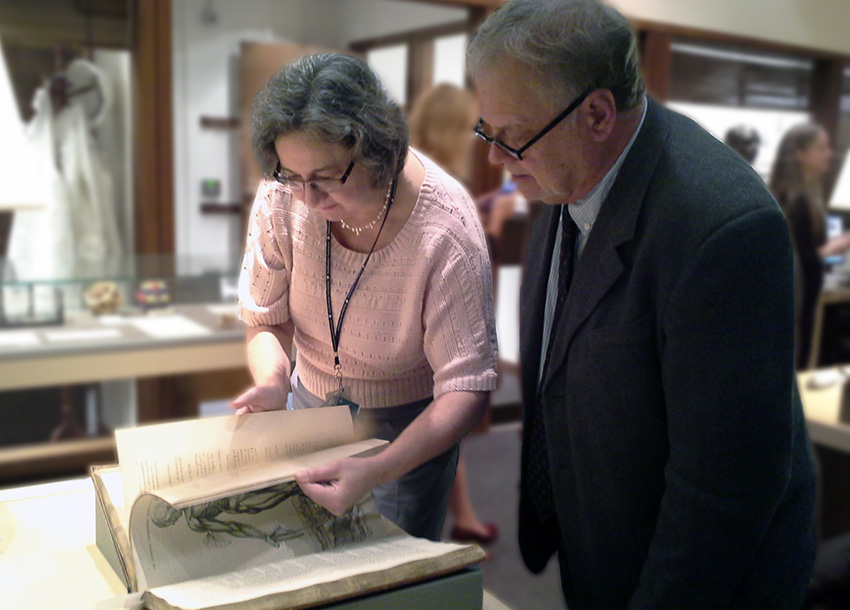 Lilla Vekerdy, head of special collections at Smithsonian Libraries, shows an anatomy book to ALA Executive Director Keith Michael Fiels.