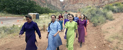 Community members attend a memorial service Saturday, Sept. 26, 2015, in Hildale, Utah, hosted by two polygamous towns on the Utah-Arizona border for 12 women and children swept away in a deadly flash flood. AP Photo/Rick Bowmer
