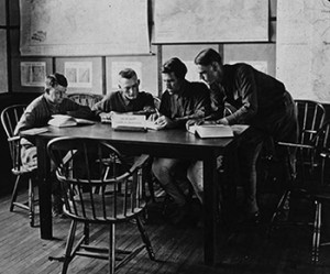 A group of four soldiers read in the ALA Camp Library at Camp Travis, Texas, 1918.