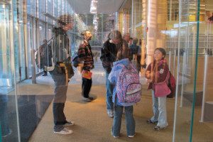 Visitors experience the reinvented Cambridge (Mass.) Public Library at its October 2009 reopening, and are reflected in the moment. Photo: Edward Lifson