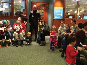 "Children participate in ""Keep Me Safe Storytime"" with their parents at Beebe Memorial Library."