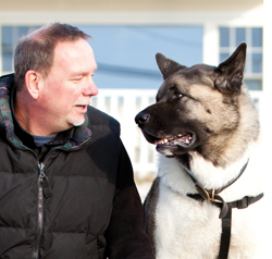 The Pet Partners therapy dog team of Brad Cole and Spartacus. Photo: Pet Partners