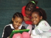 Three young girls utilize the Reading Nook, an area that will become among the most popular areas of the library.