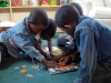 Most children had never put together a puzzle before,  but these boys quickly picked up the skills.