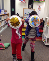Girls at Alexandria (Va.) Library make shields of courage as part of the Girls of Courage program.