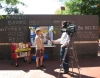 Zanne Macdonald, a librarian at Jefferson-Madison Regional Library in Charlottesville, Virginia, answers questions for the local media about the library's display at a downtown Free Speech Wall.