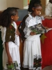 Children of Mekele read for assembled dignitaries.