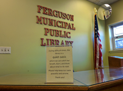Sign inside Ferguson (Mo.) Public Library