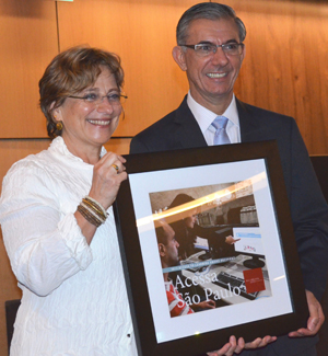 Davi Zaia (right), secretariat of public management for the Saõ Paulo State Government in Brazil, accepts the 2013 Access to Learning Award of $1 million from Deborah Jacobs, director of Global Libraries for the Bill and Melinda Gates Foundation. Photo by Carlon Walker