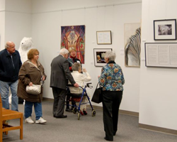 "Attendees at the State Library of Ohio's ""Parallel Arts-Women Create"" exhibit."
