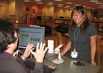 Leah Esquerra (right) is a social worker at San Francisco Public Library. She helps provide support to homeless patrons who gather at the library.