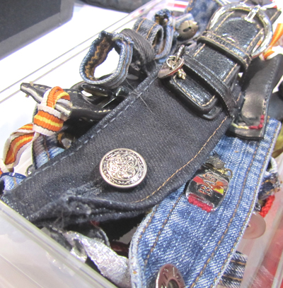 Arystocrafts, featured rock star wrist cuffs, denim loop rings, pressed flower bookmarks, denim bags, and hard cover book covers repurposed into handbags.