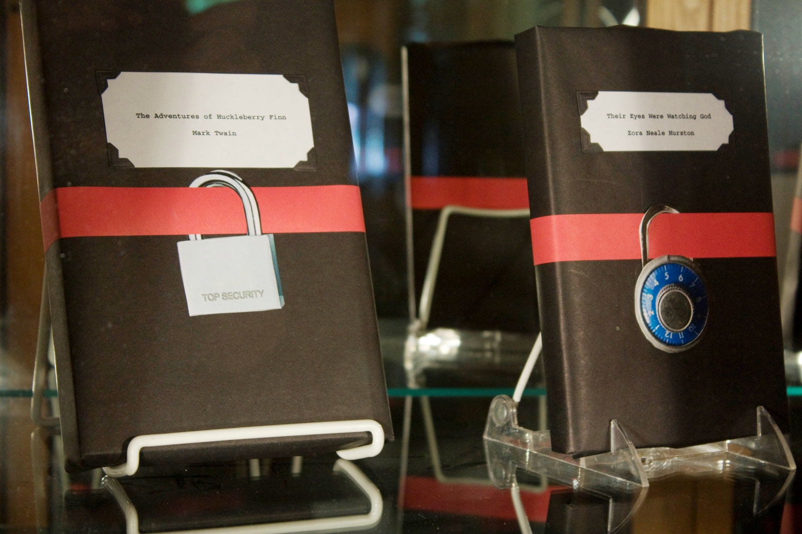 Books are under imaginary lock-and-key in a display at Columbia College Library in Chicago.