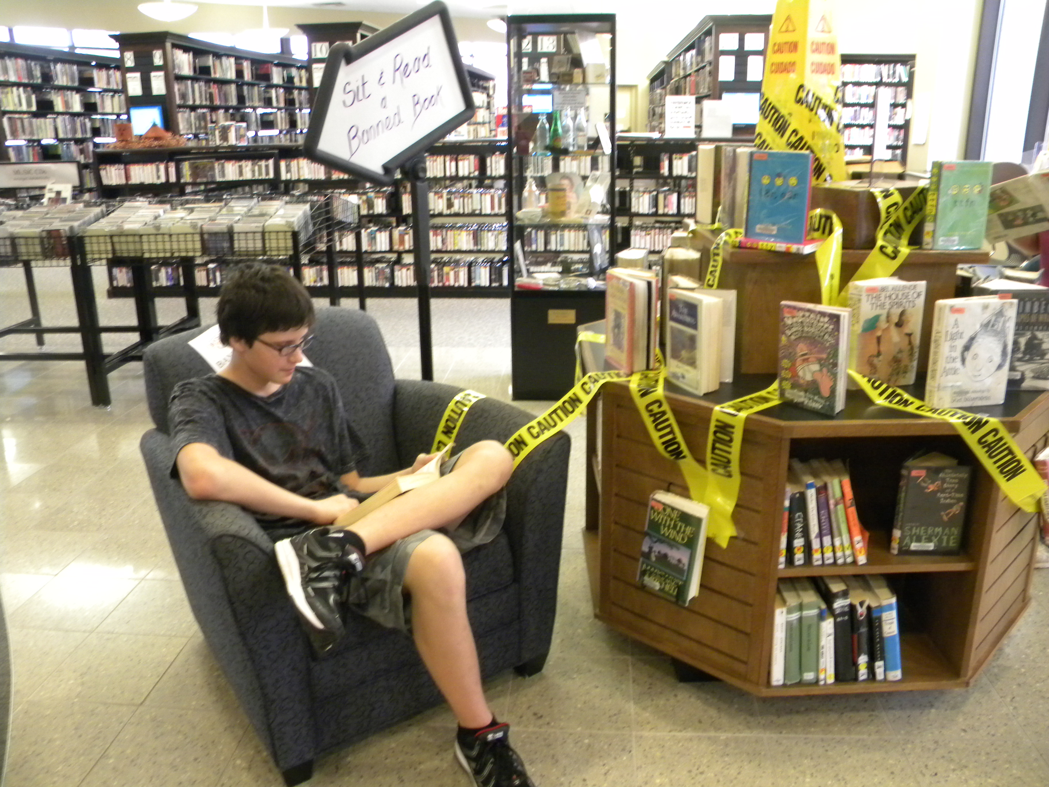 Teen Advisory Group member Danijel Divkovic reads a banned book in the display area at Guthrie Memorial Library in Hanover, Pennsylvania.