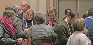 Attendees network with DPLA representatives at Midwinter. Photo by Stephen M. Brooks