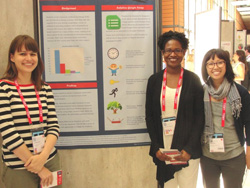 (From left) Glenda Insua, Mireille Djenno, Annie Pho of University of Illinois at Chicago library present a poster at WLIC 2014.